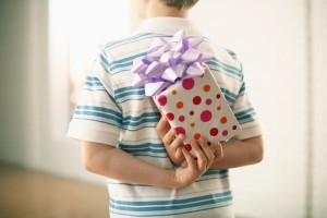 Boy Hiding Gift Behind His Back